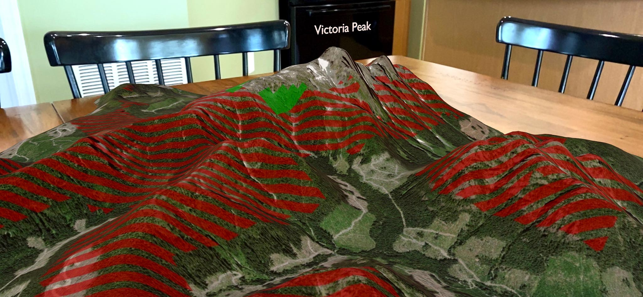 Screenshot from an iPhone of an augmented reality map showing Victoria Peak on a kitchen table.